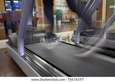running on treadmill - stock photo