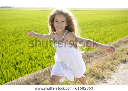 running open arms little happy girl green meadow field track - stock photo