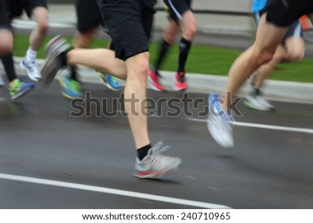 Running Race Motion Blur. Marathon runners on a city street. Motion blur.  - stock photo