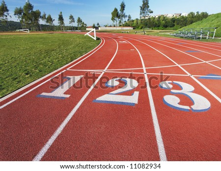 Running rack showing the 1, 2 and 3 lanes at the starting line - stock photo