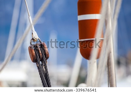 Running rigging gear and sailing rope. Ship tackles on on board yacht. - stock photo