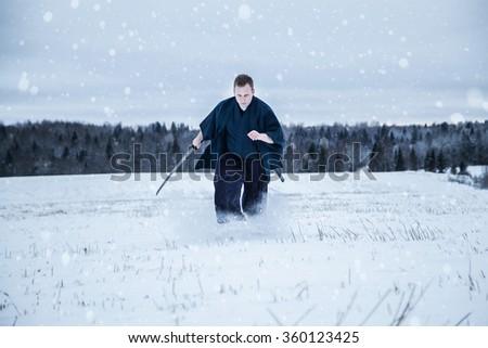 running Samurai with japanese sword in snowy field