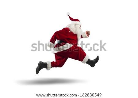 Running Santa Claus isolated on white background - stock photo