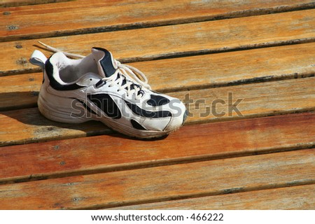 Running Shoe on Wood Deck - stock photo
