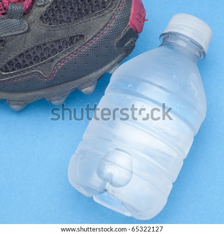 Running Shoe with Bottle of Water Health and Fitness Concept.