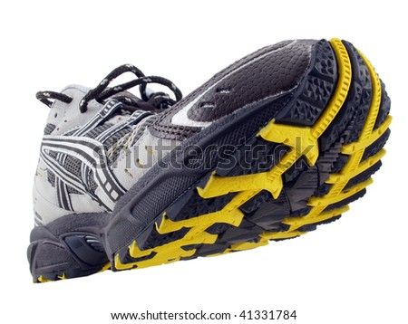 Running Shoe with yellow and black tread pattern tilted up on white