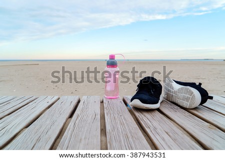 running shoes and water - stock photo