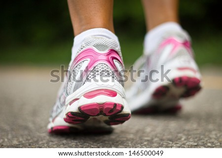 Running shoes close-up.  Female runner. - stock photo