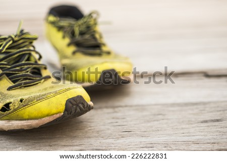 Running shoes on a wooden background - stock photo