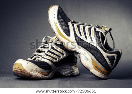Running shoes on grey background. - stock photo