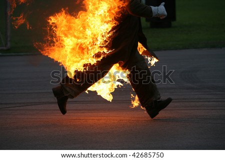 running stunt man on fire - stock photo