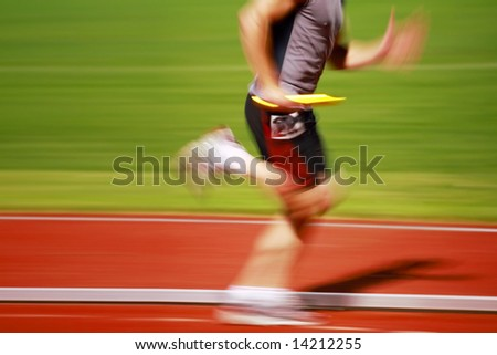 Running the Baton (motion blur) - stock photo