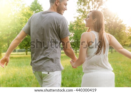 running to the sun together - stock photo