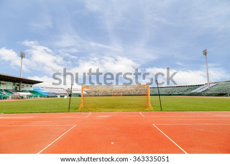 Running Track and soccer field grass Goal at the stadium Soccer field - stock photo