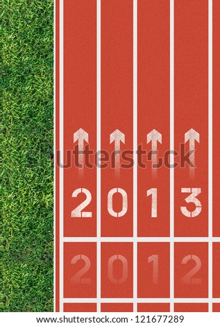 Running track announcing the coming of the new year 2013. - stock photo