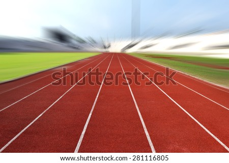 Running Track At A Sport Stadium (radial blur up image) - stock photo