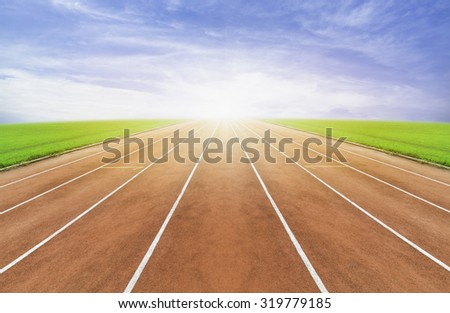 Running track  , blue sky - stock photo