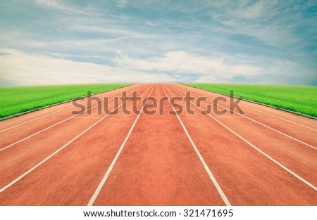 Running track , blue sky ,vintage - stock photo