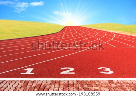 Running track for athletics and competition in the morning. - stock photo