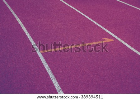 Running track for the athletes background, Selective Focus and Vintage Style. - stock photo