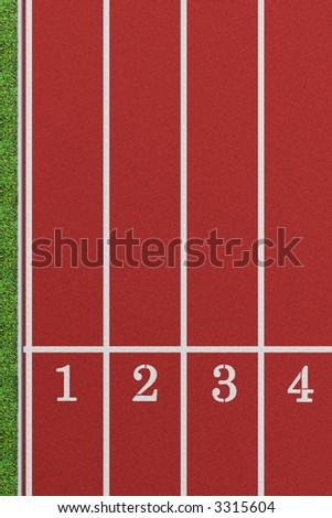 Running track from a bird's perspective showing the first 4 lanes with a patch of lawn on the left - stock photo