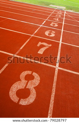Running track lanes for athletes - stock photo