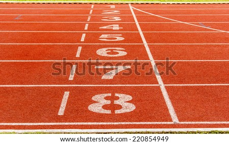 Running track number in front of tracks - stock photo