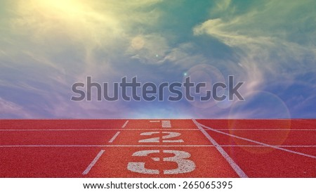 running track number standard red color under the blue sky with lens flare - stock photo