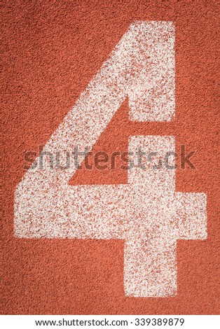 Running track numbers four in stadium - stock photo