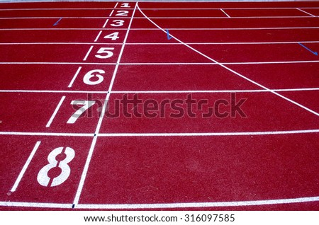 Running track numbers in front of tracks - stock photo