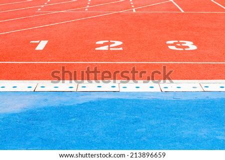 Running track numbers one two three in stadium - stock photo