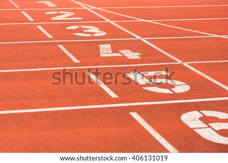 running track on a stadium with lane numbers