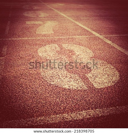 Running track racing texture with number , retro filter effect - stock photo