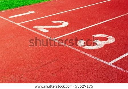 Running track starting line - stock photo