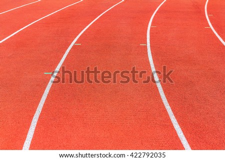 Running track texture. Running track background. Red running track at sport stadium. Athletic running track with copy space for text or image. - stock photo