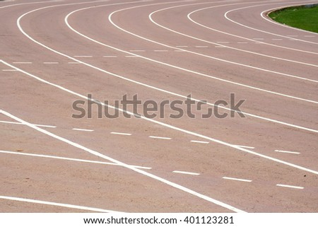Running track texture with lane numbers, Old running track. - stock photo