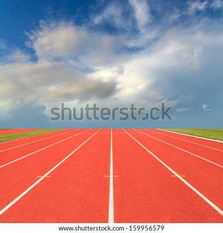 Running track with blue sky - stock photo
