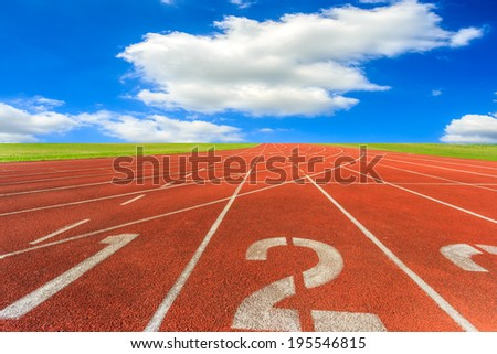 Running track with blue sky and clouds