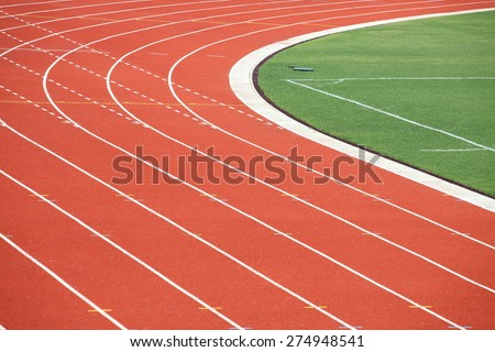 Running track with corner of the football field - stock photo