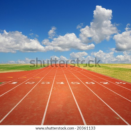 Running track with eight lanes with sky and clouds - stock photo