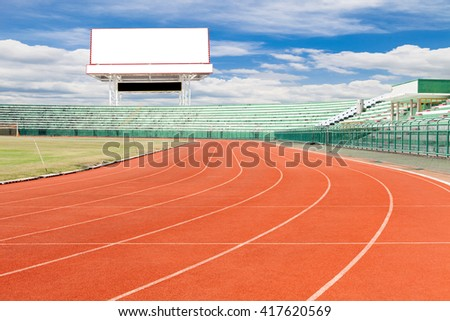 Running track with Empty white digital billboard screen for advertising in sport stadium - stock photo