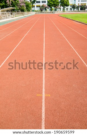 Running track with green field, Thailand
