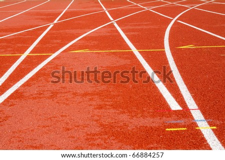 Running track with markings of a stadium - stock photo