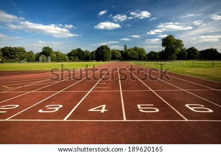 Running track with numbers - stock photo