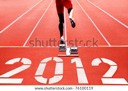 Running track with runner on start numerals of year 2012 - stock photo