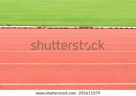 running track with soccer field  - stock photo