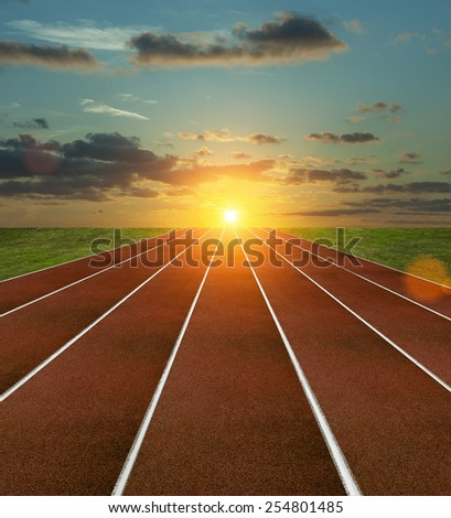 Running Track with sunset - stock photo