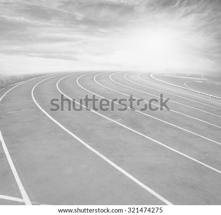 Running track  with the blue sky , black and white - stock photo