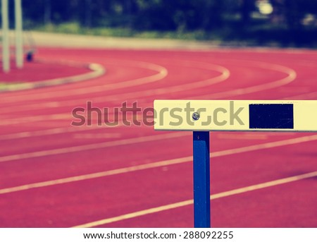 Running tracks and hurdles with a instagram and vintage effect. - stock photo
