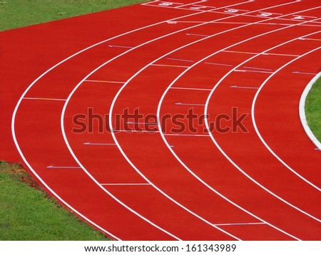 Running tracks on a sport stadium, red tartan with white lanes - stock photo